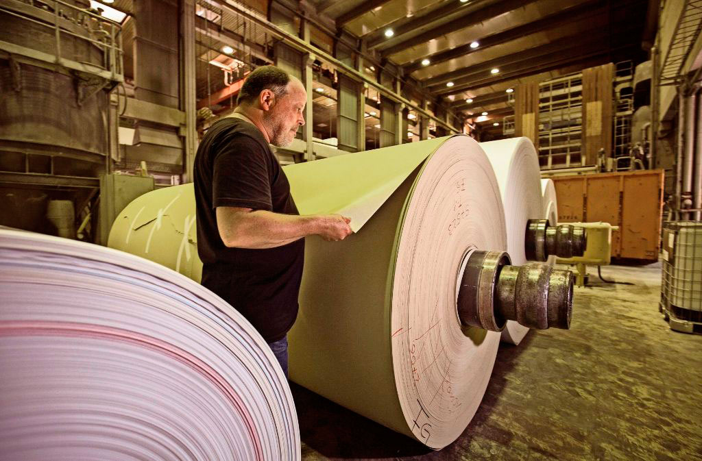Man with reels of paper